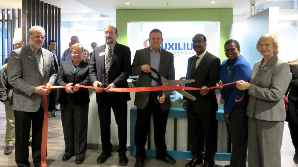 (l:r) Jerry Therrien, President, Therrien Waddell, Inc.; Cathy Drzyzgula & Neil Harris, City of Gaithersburg Councilmember's; Ed Samuels, Chief Technology Officer, Auxilium Technology; Ike Leggett, Montgomery County Executive ; Colette Releford, Marketing Executive; Gazette Newspapers and Catherine Rossi, Senior Associate, ROSSI Commercial Real Estate, LLC at the Gaithersburg-Germantown Chamber conducted Ribbon Cutting Ceremony for Auxilium Technology in Gaithersburg on January 20, 2015.