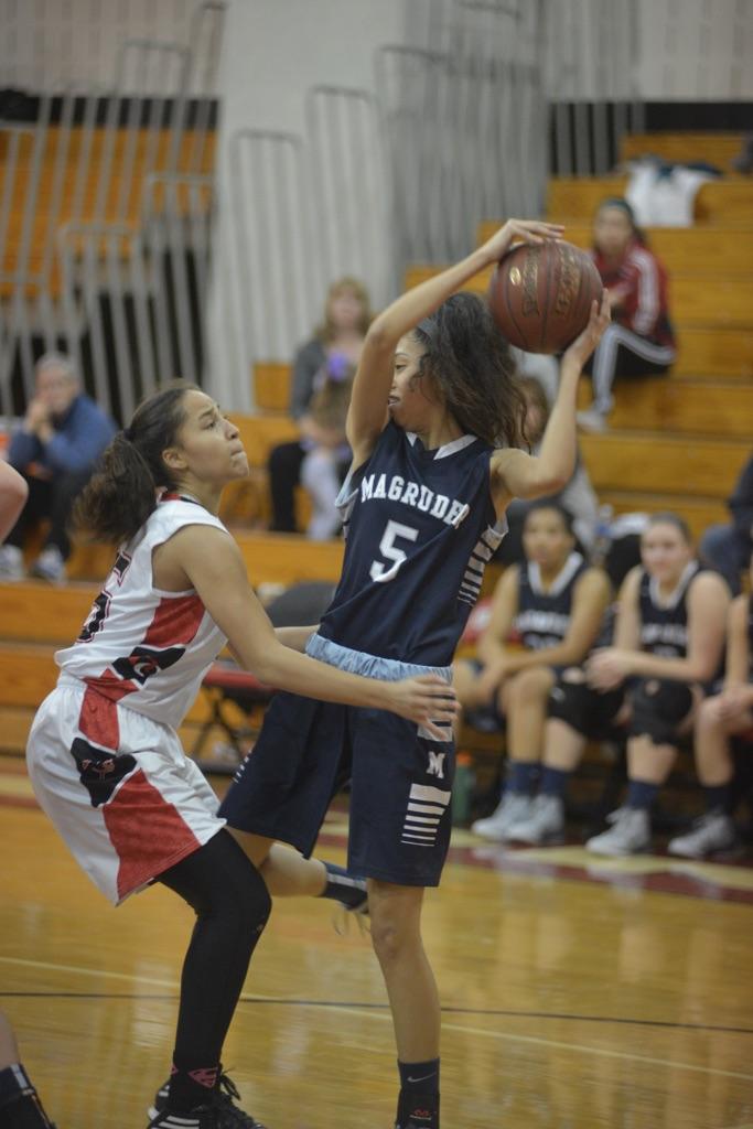 Girls Varsity Magruder at QO basketball game