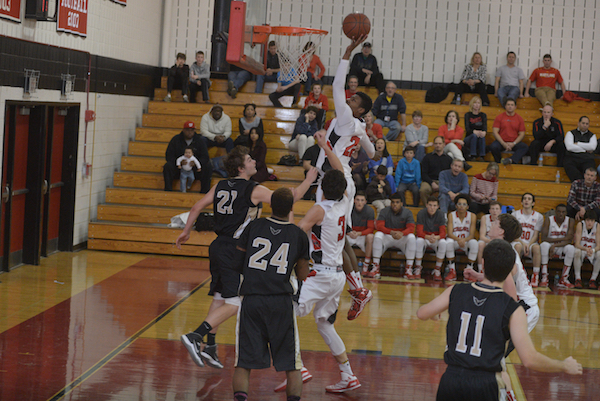 photo of Quince Orchard vs Poolesville boys basketball game 1/20/15