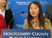 photo of Dahlia Huh at the press conference following change to school bell times