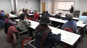photo of adults attending a seminar