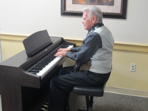 John Phillips, a resident of Riderwood, performs some of his favorite pieces at the opening of the February meeting of the retirement community's Piano Club.