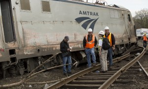 NTSB Recorder Specialist  works with officials on the scene of the Amtrak Train #188 Derailment in Philadelphia