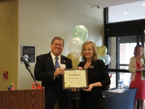 """(l:r) City of Gaithersburg Mayor Jud Ashman presents Leila Beltramo, Director of Sales, Hampton Inn & Suites - Washington, DC North - G'burg, with a proclamation claiming June 12, 2015 as """"Homewood Suites Day"""" at the official Grand Opening / Ribbon Cutting Ceremony of the new Homewood Suites Gaithersburg held on June 12, 2015.  (photo credit: Laura Rowles, GGCC Director of Events & Marketing)"""