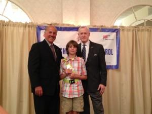 Student Ivan Glerum with AAA Joe Beddick and AAA Lon Anderson