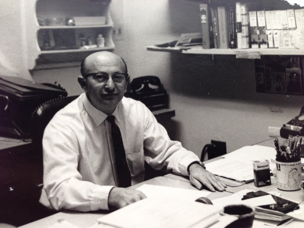 Harry sitting behind his desk, 1960s