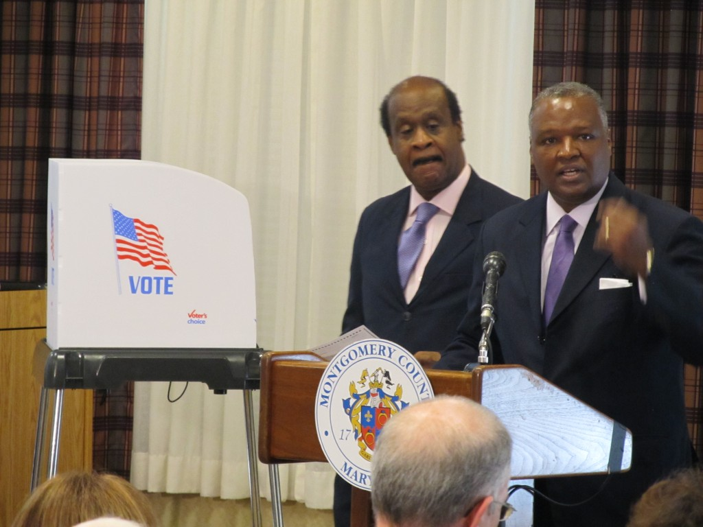 """Montgomery County Executive Isiah """"Ike"""" Leggett (left) and Prince George's County Executive Rushern Baker kick-off a public awareness campaign regarding new voting machines to be used in the 2016 presidential election.  The event took place on September 22 at Riderwood retirement community."""