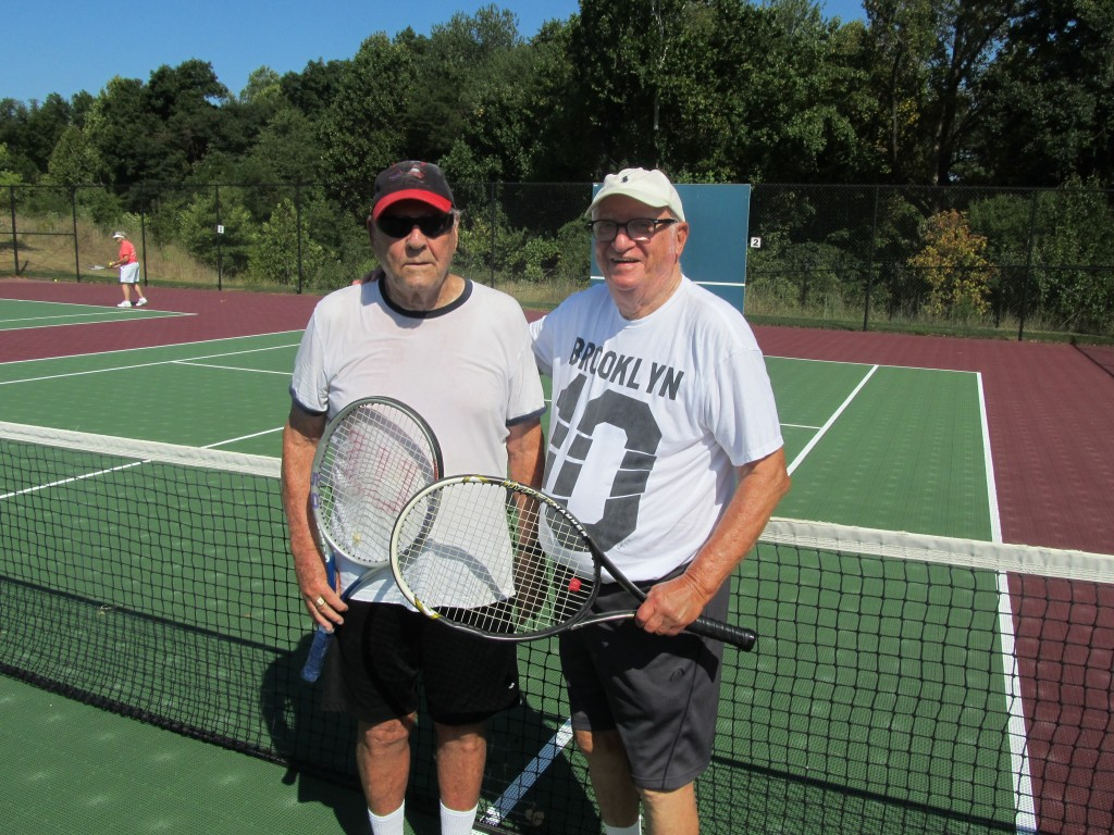 Ed Milligan (L) and Joel Sarnoff (R), are pictured following their victory in the championship match in men's doubles division.  The Riderwood residents competed in the Annual Erickson Living Tennis Tournament in Silver Spring on September 9.