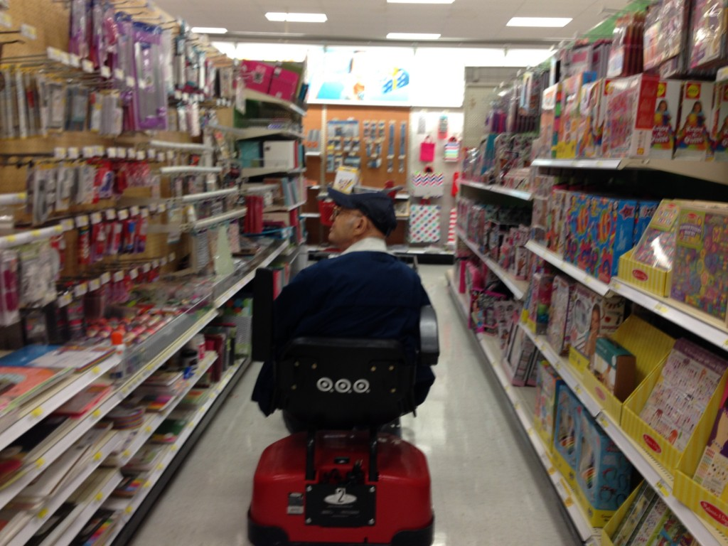 In 2014, at age 92, Harry enjoyed zooming up and down the store aisles. Here he was shopping for office supplies, such as labels and tape for boxing up items he mailed regularly to family and friends. He also enjoyed opening up his own piles of mail and packages every day.
