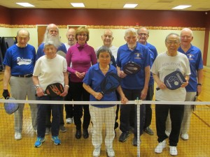 Resident members of the Riderwood Pickleball Group take a moment to have their photo taken with Pirkko Pontinen (pink sweater-middle), a television reporter with the Finnish Broadcasting Company. Ms. Pontinen is a Washington-based correspondent assigned to national stories such as the presidential campaign.