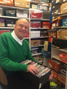Glenn Greenwood, a resident of Riderwood retirement community, poses with his collection of golf scorecards.  He estimates having over 25,000 cards from the United States and around the world.