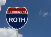 An American road interstate sign with words Retirement and Roth with sky, Your Roth Retirement Fund