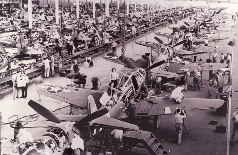 """This photo caption on the Airport Journals website reads: """"Workers are busy on the P-39 Airacobra assembly line at Bell Aircraft's Niagara Falls plant. By the time the war ended, Bell had produced 9,584 P-39s. A few examples managed to survive; at last count, three were still flying."""" It's possible Harry was in this photo (right center of photo, the balding man standing at the wing with his back to the camera)."""