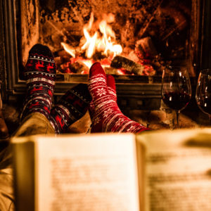 read book fireplace holiday featured