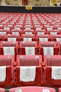 Whiteout Frese Fest towels lay upon the inner bowl seats at the Xfinity Center