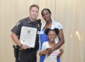 (l:r) Montgomery County Police, 5th District Officer Jonathan Pruziner, Mary & Sahara Wimpy were excited to be able to honor Pruziner with the Distinguished Service Citation after he saved the life of Sahara Wimpy, an autistic child, who had gone missing. (Photo compliments of Phil Fabrizio, PhotoLoaf® - Live. Love. Play. Loaf.)     (Photo by Phil Fabrizio)